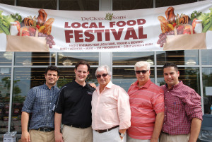 The DeCicco family - Chris, John Jr., John Sr., Joe Jr. and Joe Jr. - stand in front of the Brewster store during the 2014 Local Food Festival