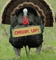Turkey with a sign saying Drink Up!