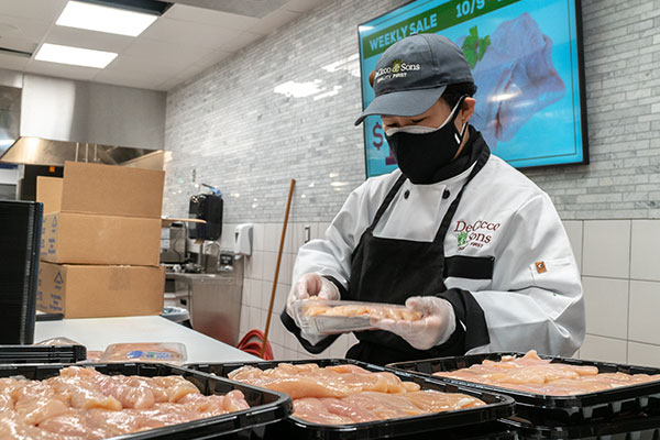 meat department packing deciccos natural chicken